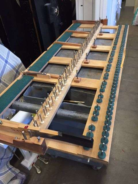 Steinway grand piano key frame being serviced