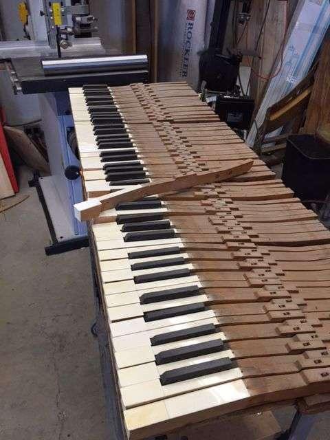 Vintage ivory key set being serviced